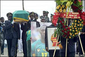 Police officers carry the coffin of Marc Vivien Foe