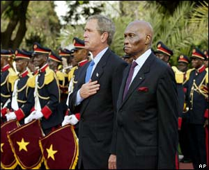 US President George W Bush is welcomed to the presidential palace in Dakar by Senegal's President Abdoulaye Wade