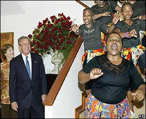 Mr and Mrs Bush watch singers in South Africa