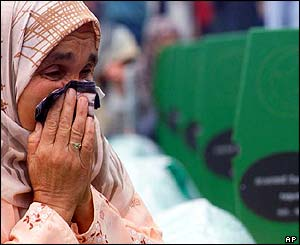 Hura Hrnjic, 60, weeps at the grave of her husband Meho