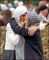 Muslim women hugging