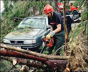 Firefighters clear fallen trees at the La Rive campground near Biscarosse