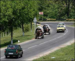 Wagons on the road - with cars overtaking