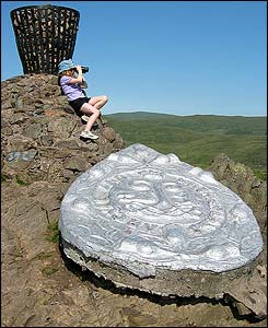 Heather Smith takes in the view from the cairn on the summit of Dumyat in the Ochils - sent by her dad, Brian