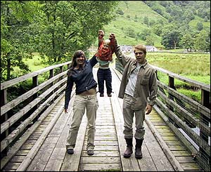 Angus, Susan and Fritz Robertson, from Glasgow, cross a bridge at the top of Loch Lomond