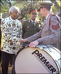 Nelson Mandela meets members of the Military Health Services band outside his home