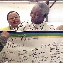 Nelson Mandela (front) and his wife Graca Machel (back) with messages presented to him