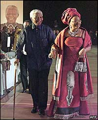 Nelson Mandela and his wife Graca Machel arrive for the star-studded party
