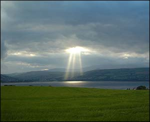 Dingwall is illuminated by rays of sun breaking through the clouds - sent by Dougie Johnston