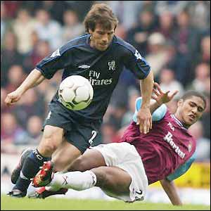 Former Chelsea star Gianfranco Zola is tackled by new Blues signing Glen Johnson, pictured playing for West Ham