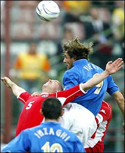 Christian Vieri climbs above Robert Page to head a goal