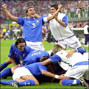 The Italian players celebrate