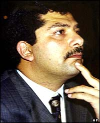 Qusay Hussein listens to a speech by his father (image: May 2001)