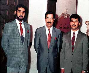 Uday (L) and Qusay flank their father (image: 1992)