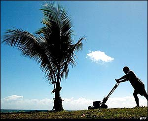Man mowing the landing strip for the force's aircraft, near Honiara