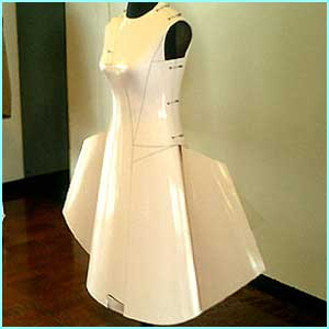 Designer Hussein Chalayan was inspired by flight technology to create the Airplane Dress, which is made from the same material used in aircraft construction .
