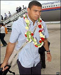 Ronaldo walks across the tarmac after leaving the plane