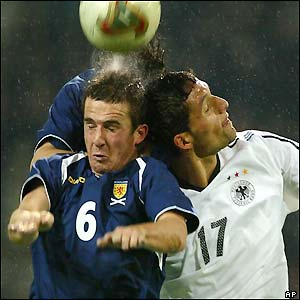 Gemany's Kevin Kuranyi and Scotland's Barry Ferguson clash heads as they fight for the ball