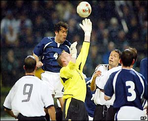 Scotland keeper Robert Douglas fails to hold a Ballack shot and Germany score