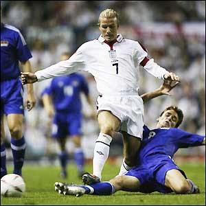 Beckham fights off the Liechtenstein defenders