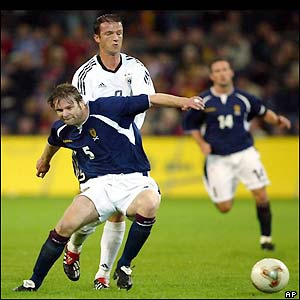 Scotland's Steven Pressley challenges Bobic for the ball