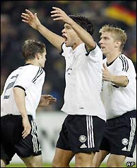 Michael Ballack celebrates his penalty strike