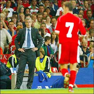 Wales boss Mark Hughes looks on as Jason Koumas is dismissed