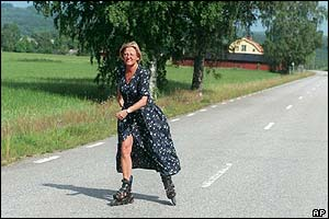 Skating at her summer home in Dalarna, Sweden, July 1997