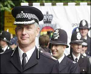 Commander Brian Paddick leads uniformed police officers
