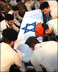 Israeli army officers bury Captain Yael Kfir who was killed in the suicide bomb attack near the Tsrifin army base Tuesday