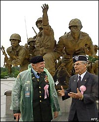 Two US Veterans in front of the war memorial