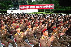 North Korean soldiers applaud as they attend a ceremony, a day ahead of the 50th anniversary of Armistice day of the Korean War in Pyongyang, North Korea