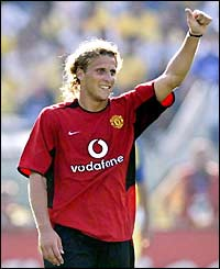 Diego Forlan celebrates after his second goal