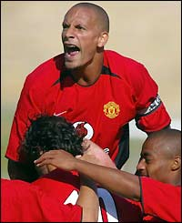 Rio Ferdinand celebrates with Ruud van Nistelrooy after the Dutchman opens the scoring