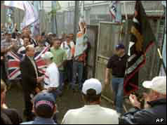 Crowds surrounding door as prisoner leaves