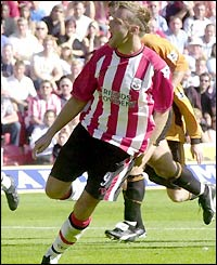 James Beattie celebrates scoring from the spot