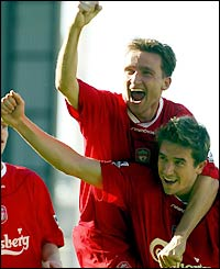 Liverpool's Vladimir Smicer congratulates Harry Kewell on his goal