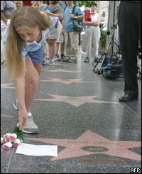Ten-year-old Rebecca Neumann, from Texas, leaves flowers beside Bob Hopes star on the Hollywood Walk of Fame