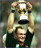 Francois Pienaar holds aloft the Rugby World Cup