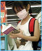 A young girl reading OOTP
