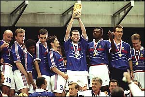 Zinedine Zidane (centre) lifts the World Cup after France win on home soil in the 1998 final