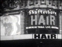 Front of theatre advertising production of Hair