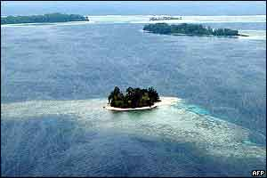 Kennedy Island (front) sits atop its own reef in the remote Western Province of the Solomon Islands