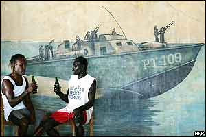 Tingo Leve (L) and Solo Lamusalanga (R) enjoy a beer at the PT-109 Bar on Ghizo Island
