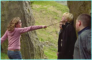 Hermione gets serious as she points her wand at Draco, played by Tom Felton, and his chums