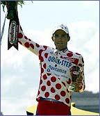 Richard Virenque in polka-dot on the podium in Paris