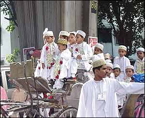 Children on horse-drawn carriage in the wedding procession