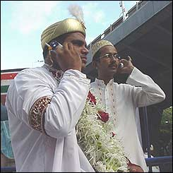 Grooms conducting business on their mobile phones