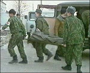 Russian soldiers taking away the injured and dead