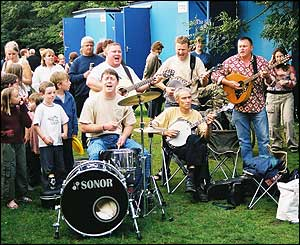 A band plays near the portable loos at the festival